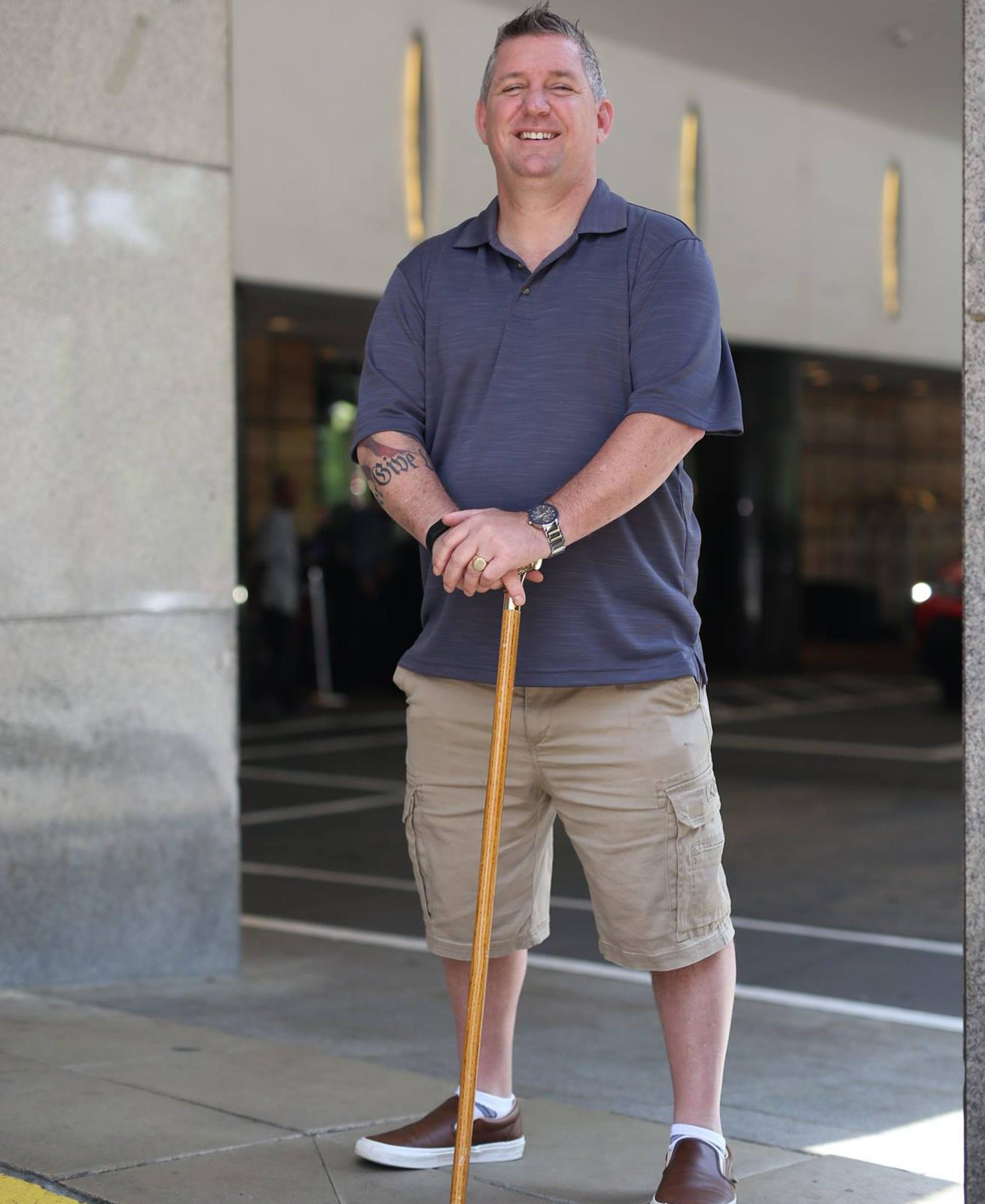 Smiling man with cane