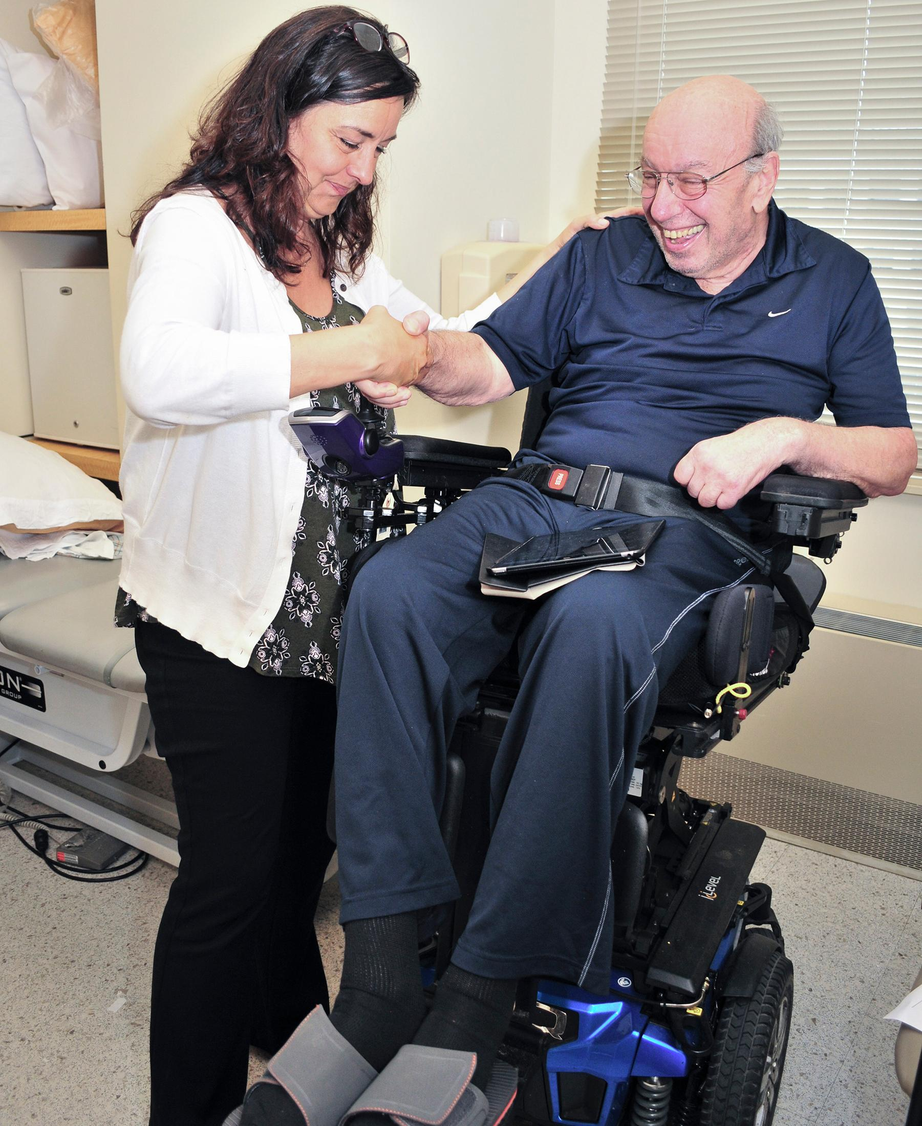 man in wheelchair receiving care from doctor
