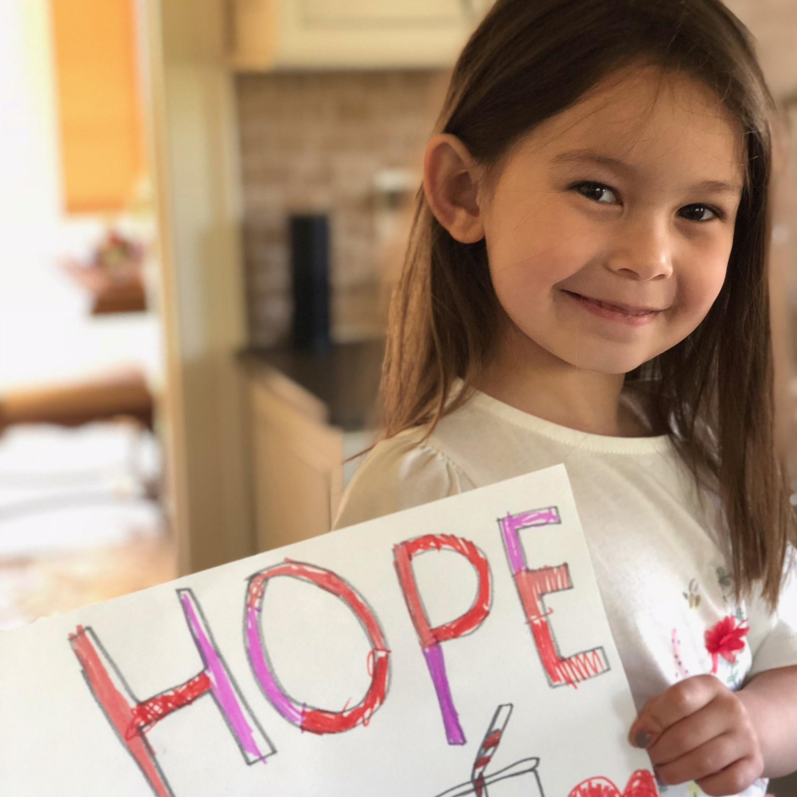 Little Girl with HOPE sign